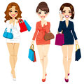 Beautiful business women shopping three in suit dresses happy walking carrying bags Stock Photography