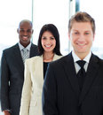 Beautiful businesswoman in focus with her team Royalty Free Stock Photo