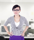 Beautiful businesswoman pose at office with confident gesture in Royalty Free Stock Photography