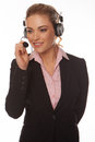 Beautiful businesswoman speaking on a headset Royalty Free Stock Photo