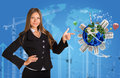 Beautiful businesswoman in suit finger points to earth with buildings map of world construction site and arrows background Stock Photos