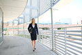 A beautiful businesswoman walking in a business building Royalty Free Stock Photo