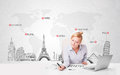 Beautiful businesswoman with world map and major landmarks of th young the Stock Photo