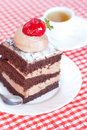 Beautiful cake with strawberry and tea Stock Photos