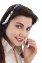 Beautiful call center agent holding a mouthpiece of her headphone Stock Image