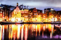 Beautiful calm night view of Amsterdam city. The works in the st
