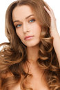 Beautiful calm woman with long curly hair glamour beauty and health concept Royalty Free Stock Images