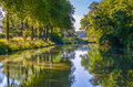 Beautiful Canal du Midi, sycamore trees and water, Southern France Royalty Free Stock Photo