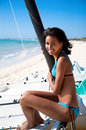 Beautiful caribbean woman smile on tropical beach close up Stock Image