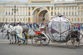 Beautiful carriage on Palace Square. People in carriage at Palace Square near Winter Palace of St. Petersburg. Summer 2016.