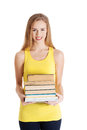 Beautiful casual caucasian woman student holding stack of books. Royalty Free Stock Photo