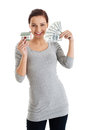 Beautiful casual woman holding money and house. Royalty Free Stock Photo