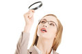 Beautiful caucasian business woman with magnifying glass. Stock Photo