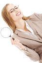 Beautiful caucasian business woman with magnifying glass. Royalty Free Stock Image