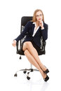 Beautiful caucasian business woman is sitting on a chair with he