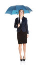 Beautiful caucasian business woman standing under umbrella isolated on white Stock Photo