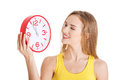 Beautiful caucasian casual woman holding red clock. Royalty Free Stock Photo