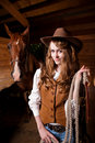 Beautiful caucasian cowgirl with a horse Stock Images