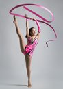 Beautiful caucasian girl gymnast with a ribbon pink Stock Images