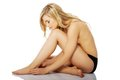Beautiful caucasian naked woman sitting. Royalty Free Stock Photo