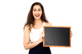 Beautiful Caucasian woman holding empty blackboard over white background