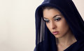 Beautiful caucasian young mysterious woman in black veil Stock Images