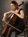 Beautiful cello player photo of a female musician playing a Royalty Free Stock Photos