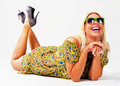 Beautiful cheerful blonde in green sunglasses Royalty Free Stock Photo