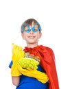 Beautiful cheerful child dressed as superhero cleaning having fun with a sponge and a sprayer concept Stock Photos