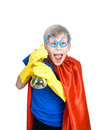 Beautiful cheerful child dressed as superman cleaning with a sponge and a sprayer concept Stock Images