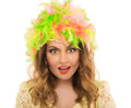Beautiful cheerful girl in a color wig and beautiful up make up on white background Royalty Free Stock Image