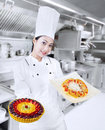 Beautiful chef serving fruit cake pizza Royalty Free Stock Photo