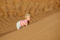 Child climbing sand dune Royalty Free Stock Photo