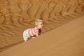 Child climbing sand dune