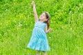 Beautiful child girl in park. Happy kid having fun outdoo Royalty Free Stock Photo