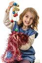 Beautiful child girl with shiny christmas decorations little in hands isolated on white Royalty Free Stock Photography