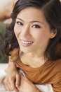 Beautiful chinese oriental asian woman smiling a young with a wonderful toothy smile Royalty Free Stock Photos