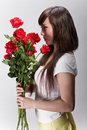 Beautiful chinese woman smelling roses Stock Image