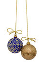 Beautiful Christmas balls are suspended on a gold thread, isolat