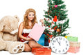 Beautiful christmas girl isolated white background near tree and toys