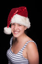 Beautiful christmas girl smiling, on black Stock Photos
