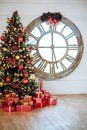 Beautiful Christmas living room with decorated Christmas tree, gifts in front of whate wall. New year tree with red and Royalty Free Stock Photo