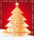Beautiful christmas tree with greetings in several languages written Stock Photo
