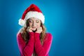 Beautiful christmas woman portrait of attractive isolated on blue studio shot in hat Stock Photo
