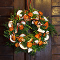 Beautiful christmas wreath door decoration with fruits Royalty Free Stock Image
