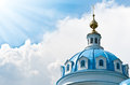 Beautiful church against blue cloudy sky. Royalty Free Stock Photo