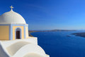 Beautiful church on the caldera and ships in the bay fira sant domed volcanic with distance sunset santorini thira cyclades Royalty Free Stock Images