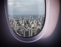 Beautiful city view from the window of bangkok with blue sky plane Royalty Free Stock Images