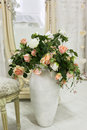 Beautiful classical room with vintage table vase and flowers heart decorations and pictures Stock Image