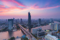 Beautiful cloud background,  Modern Business Building along the river curve  in Bangkok city Royalty Free Stock Photo